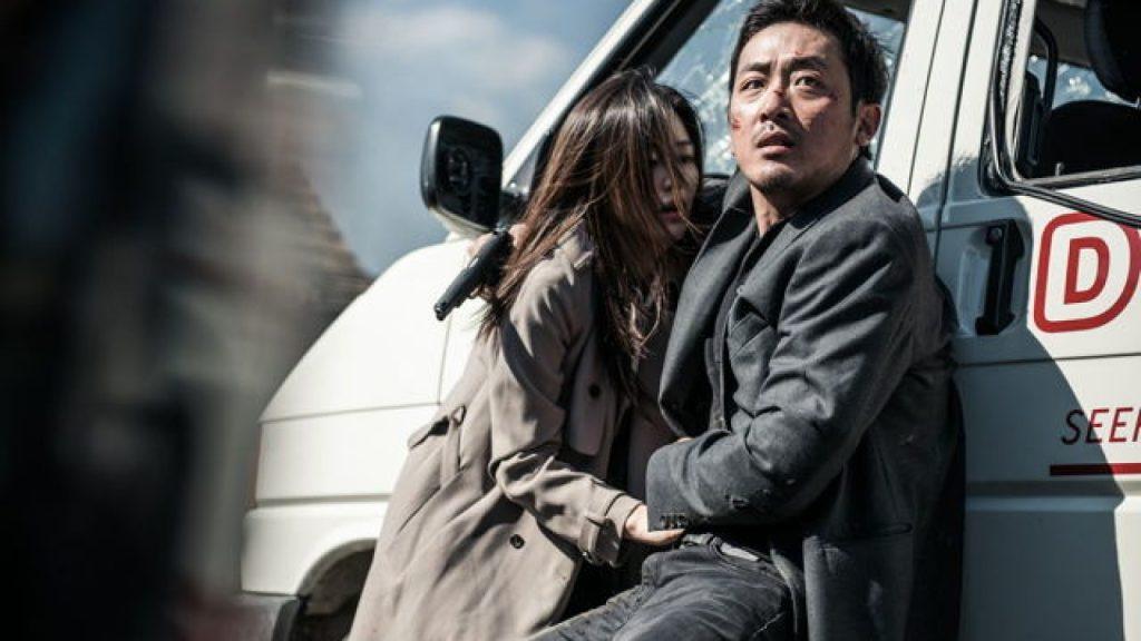 Ha Jung-woo standing next to a car
