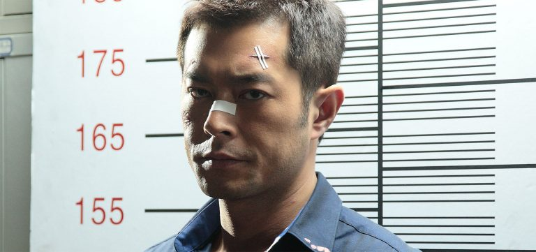 Louis Koo wearing a suit and tie