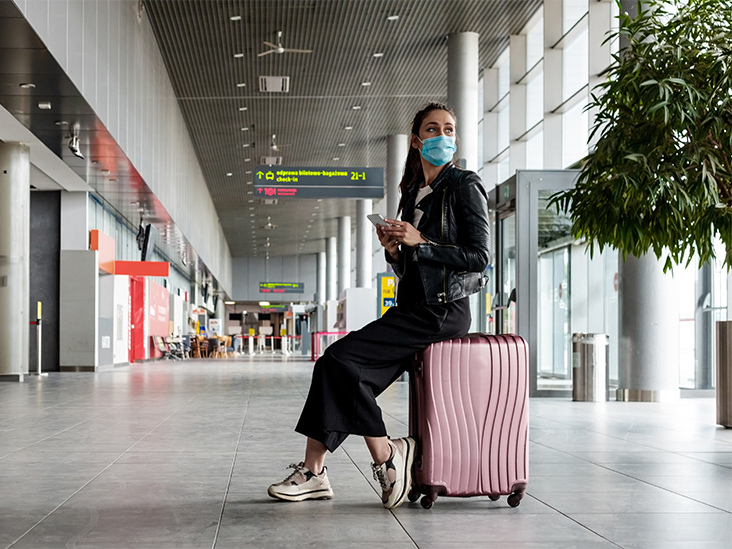 A person holding a bag of luggage