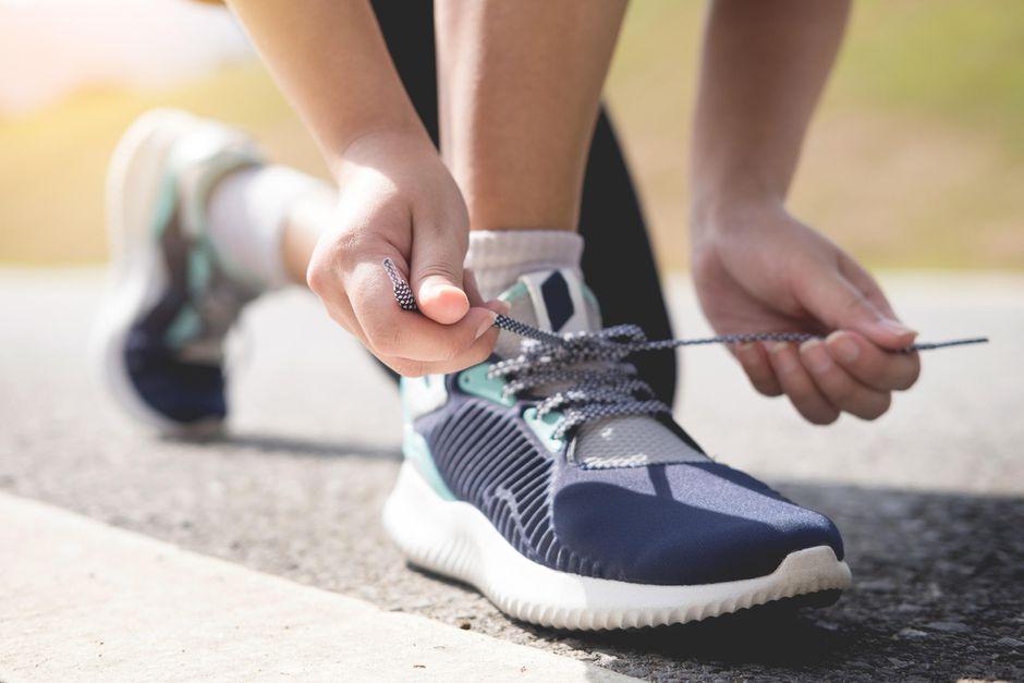 A person holding shoe laces