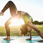 A girl doing yoga and background sun