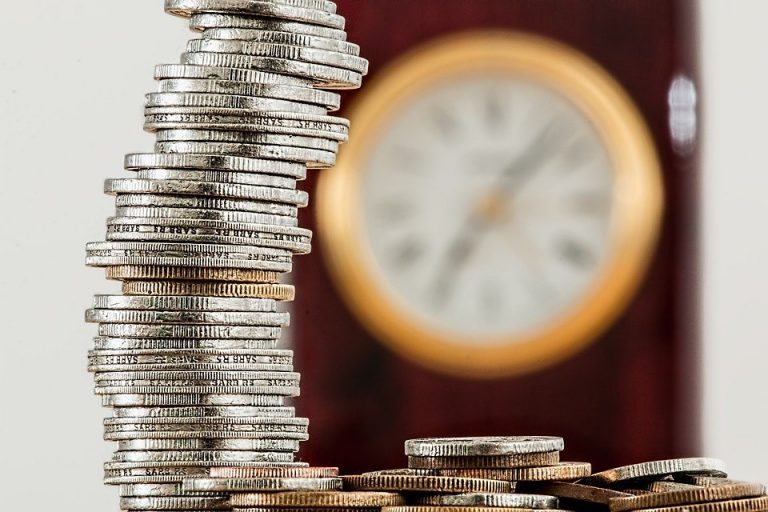 A coins on table background clock