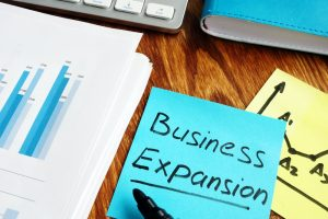 Business expansion written on a piece of paper.